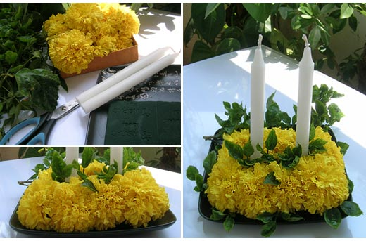 Easy Floral Centerpiece made with Rich Indian Marigold, Hibiscus Leaves, White Candles and Love