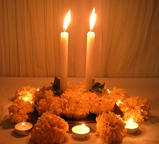 Exotic Marigold Flowers and White Candles as Table Centerpiece