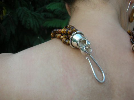 Clusters of Tigers Eye Beads with a Chunky Silver Clasp