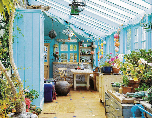 dash of blue in sunlit sunrooms making a great place for gardening and potting