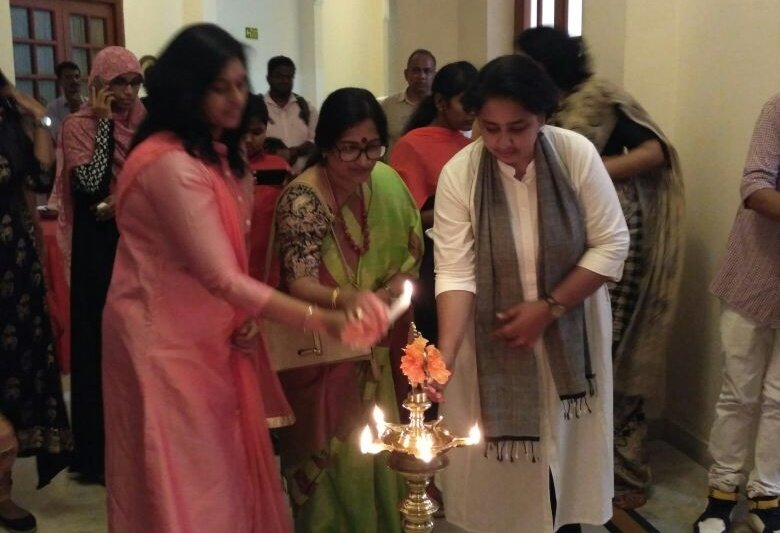 Participating women artists lighting the inaugural lamp