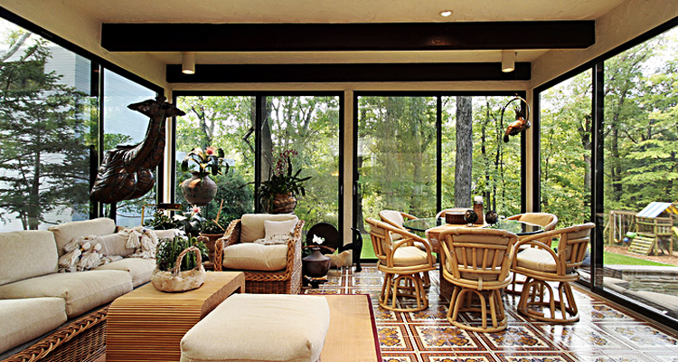 large windows in sunroom and modern decor