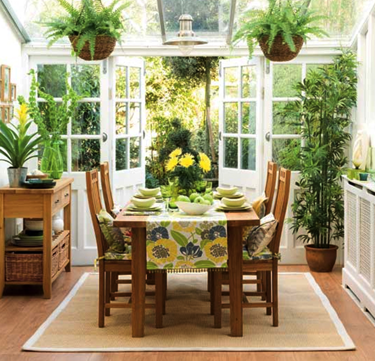 Simple and elegant dining and entertaining in sunlit sunrooms with ferns palms and wooden decor